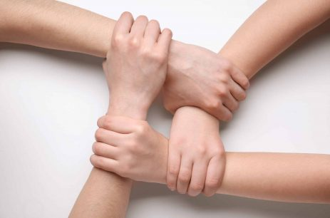 People holding hands together on white background. Unity concept